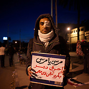December 11, 2012 - Cairo, Egypt: An injured protestor stands outside the presidential place in Cairo, where tens of thousands gathered to voice their anger at the planned constitution, which will be put to a referendum next Saturday...The Egyptian army has reportedly called talks between President Mohamed Morsi and the opposition to end violent protests against a draft constitution...Sporadic clashes between supporters and opponents of president Mohamed Morsi, erupted in the past week over his assumption of extraordinary powers and the scheduling of the referendum. (Paulo Nunes dos Santos/Polaris)