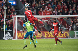 December 9, 2017 - Toronto, Ontario, Canada - Toronto FC defender JUSTIN MORROW (2) heads the ball over Seattle Sounders defender KELVIN LEERDAM (18) while Toronto FC forward JOZY ALTIDORE (17) looks on during the MLS Cup championship match at BMO Field in Toronto, Canada.  Toronto FC defeats Seattle Sounders 2 to 0. (Credit Image: © Mark Smith via ZUMA Wire)