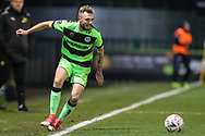 Forest Green Rovers Carl Winchester(7) keeps the ball in play during the The FA Cup 1st round replay match between Forest Green Rovers and Oxford United at the New Lawn, Forest Green, United Kingdom on 20 November 2018.