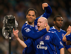 MANCHESTER, ENGLAND - Monday, February 25, 2008: Everton's goalscorer Jolean Lescott celebrates scoring the second goal against Manchester City with team-mate Lee Carsley during the Premiership match at the City of Manchester Stadium. (Photo by David Rawcliffe/Propaganda)