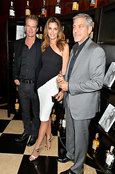 Left to right, RANDE GERBER, CINDY CRAWFORD and GEORGE CLOONEY at the London launch of Casamigos Tequila hosted by Rande Gerber, George Clooney & Michael Meldman and to celebrate Cindy Crawford's new book 'Becoming' held at The Beaumont Hotel, Brown Hart Gardens, 8 Balderton Street, London on 1st October 2015.