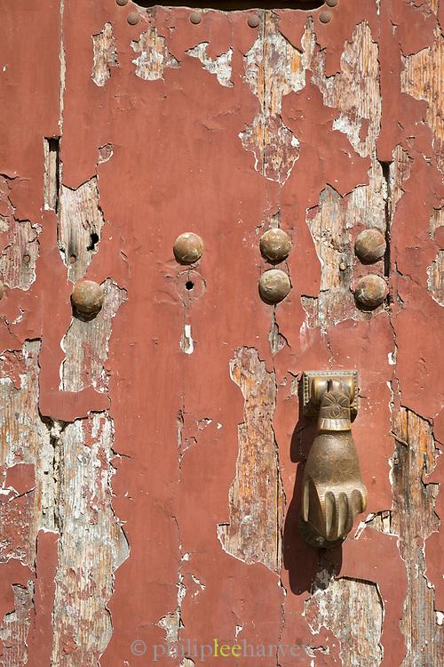 Architectural detail of old wooden door with door handle, Casablanca, Morocco