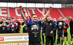 Sheffield United's Billy Sharp celebrates promotion to the Premier League after the Sky Bet Championship match at the bet365 Stadium, Stoke.