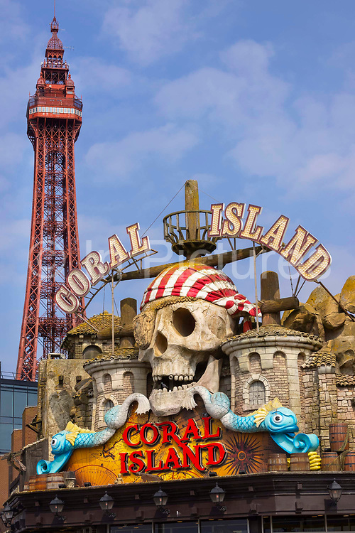 Coral Island amusements in front of the tower during the pandemic on 21st April 2021 in Blackpool, Lancashire, United Kingdom. Blackpool is a large town and seaside resort in the county of Lancashire on the north west coast of England. Blackpool was once a booming resort with it's famous promenade which now, despite having a somewhat shabby appearance, still continues to attract millions of visitors each year. During the coronavirus pandemic however, Blackpool has struggled, with empty streets and closed down businesses creating an atmosphere more like a ghost town.
