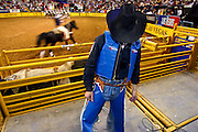 """15 DECEMBER 2002 - LAS VEGAS, NEVADA, USA: Bull rider Colby Yates, from Azle, TX, waits to competes in the 10th round of the National Finals Rodeo at the Thomas and Mack Center in Las Vegas, NV, Dec. 15, 2002. The NFR is the """"Super Bowl"""" of rodeo. Only the top 15 cowboys in each event are invited to compete at the NFR, which runs for 10 days every Decemeber. All 10 performances of the NFR sell out every year. PHOTO BY JACK KURTZ"""