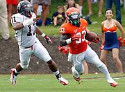 Virginia Cavaliers running back Perry Jones (33) runs past Richmond Spiders linebacker Darius McMillan (11) during the first half of the NCAA football game Saturday September, 1, 2012 at Scott Stadium in Charlottesville, Va.