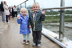© Licensed to London News Pictures. 29/08/2015. Shoreham, UK. 3 year old Katelyn and 5 year old Kyle Harman along with their mum Sam have come to the Adur Ferry Bridge to light a candle and remember those who died in the Shoreham Air Crash last Saturday August 22nd. 11 people have been confirmed dead. Today August 29th 2015. Photo credit : Hugo Michiels/LNP