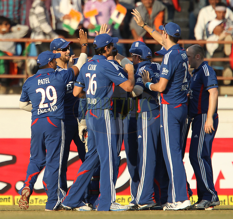 England celebrate the wicket of Ajinkya Rahane of India during the 1st Airtel ODI Match between India and England held at the SAURASHTRA CRICKET ASSOCIATION STADIUM, RAJKOT, India on the 11th January 2013..Photo by Ron Gaunt/BCCI/SPORTZPICS ..Use of this image is subject to the terms and conditions as outlined by the BCCI. These terms can be found by following this link:..http://www.sportzpics.co.za/image/I0000SoRagM2cIEc