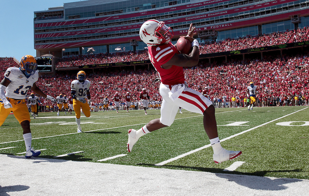 Nebraska quarterback Tommy Armstrong Jr. (4) rushes  for 34 yards before being knocked out of bound on the McNeese State 13 yard line in the third quarter of Saturday's game at Memorial Stadium in Lincoln. Nebraska defeated McNeese State 31-24.  (Independent/Matt Dixon)