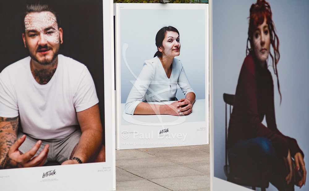 Let's Talk, a photography exhibition created in partnership with Mental Health UK At Regent's Place in London. It is designed to inspire open and honest conversations about mental health by depicting each subjects' inner battles on their faces. . Regents Place, Euston Road, London, October 08 2018.