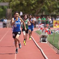 Navajo Pine Warrior Ryan Kee sprints down the home stretch in the 3200 meter run at the NMAA 2A track and field state finals in Albuquerque Friday.