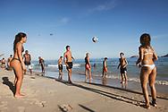 Rio de Janeiro, Brazil - March 9, 2019: Young men and women play with a soccer ball at Ipanema Beach in Rio de Janeiro, Brazil.
