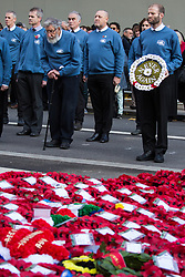London, UK. 10 November, 2019. Ben Griffin prepares to lay a white poppy wreath in front of fellow ex-services personnel from Veterans For Peace UK (VFP UK) taking part in the Remembrance Sunday ceremony at the Cenotaph. VFP UK was founded in 2011 and works to influence the foreign and defence policy of the UK for the larger purpose of world peace.