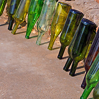 Africa, Namibia, Windhoek.  Glass wine bottles drying to be reused and recycled for making glass beads by the women of Penduka development cooperation organization in Namibia.