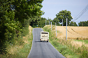 Horse lorry in country lane in Normandy France