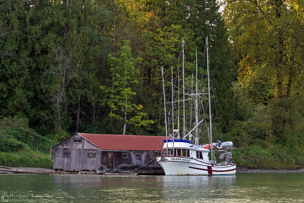 A fishing boat tied up on a dock along Bedford Channel - on the Fraser River in Langley, British Columbia, Canada