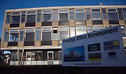 Sign advertising new prestige office development by empty 1960s office, Ipswich, England