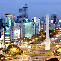 Buenos Aires, Argentina 22 August 2009<br /> Aerial view of 9 de Julio Avenue and the Obelisco monument,  in Buenos Aires.<br /> The Obelisk of Buenos Aires (Obelisco de Buenos Aires) is a modern monument placed at the heart of Buenos Aires, Argentina. Porteños refer to it simply as El Obelisco. The obelisk is one of the main icons of the city, and a venue for various cultural activities (usually sponsored by the city government) and other events. It is the traditional gathering spot for sports fans to celebrate when their favourite team wins, especially from the national football team, often resulting in colorful events that attract media coverage. It was also used by several acrobatic troupes to perform high-wire acts.<br /> Avenida 9 de Julio is the largest avenue in Buenos Aires, Argentina. Its name honors Argentina's Independence Day. (July 9, 1816) The avenue runs roughly one kilometer to the west of the Rio de la Plata waterfront, from the Retiro district in the north to Constitución station in the south. The avenue has seven lanes in each direction.<br /> PHOTO: EZEQUIEL SCAGNETTI