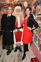 LONDON, ENGLAND 1 DECEMBER 2016:Left to right, Laura Bailey, Father Christmas, Jasmine Guinness at the 10th birthday party for the toy shop HoneyJam, 2 Blenheim Crescent, Notting Hill, London, England. 1 December 2016.