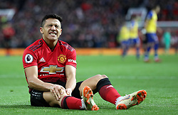 Manchester United's Alexis Sanchez reacts to an injury during the Premier League match at Old Trafford, Manchester.