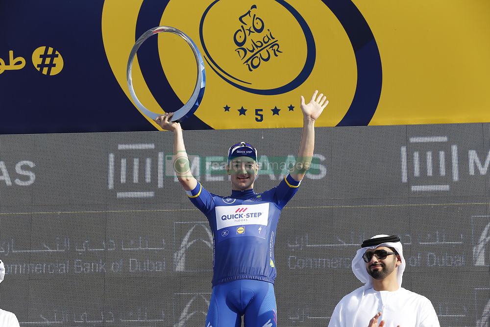 February 10, 2018 - Hatta Dam, UNITED ARAB EMIRATES - Italian Elia Viviani of Quick-Step Floors, Danish Magnus Cort of Astana Pro Team and Italian Sonny Colbrelli of Bahrain-Merida celebrate on the final podium of General Classification after the fifth and last stage of the Dubai Tour 2018 cycling race, 129 km from the Skydive and the city WAlk in Dubai, United Arab Emirates, Saturday 10 February 2018. The Dubai Tour 2018 is taking place from 6 to 10 February. ..BELGA PHOTO YUZURU SUNADA (Credit Image: © Yuzuru Sunada/Belga via ZUMA Press)