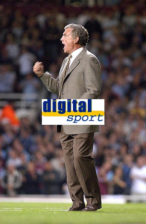 Photo. Glyn Thomas<br />West Ham Utd v Bradford City. Nationwide Division 1.<br />Upton Park, West Ham, London. 26/08/2003.<br />West Ham's caretaker manager Trevor Brooking is delighted with his side's first half goal, scored by Jermaine Defoe.