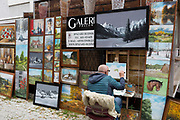 A local artist of Polish landscapes, animals and portraits, displayed on Krupowki Street, on 16th September 2019, in Zakopane, Malopolska, Poland.