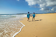 Boys running on Beach, East Coast - Australia