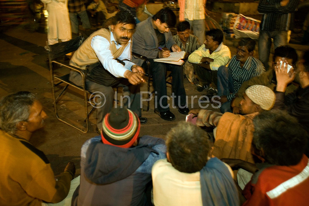 A psychiatrist and a social worker lead a group therapy session in Urdu Park for the homeless and addicted poor. The work is part of an outreach program from the Institute of Human Behaviour and Allied Sciences in Delhi. The effort is part of a unique street clinic project, that aims to treat the mentally unstable homeless on the street.<br /> It is estimated that around than 150000 people - more than one percent of the city - is homeless and, with constant migration this is increasing on a daily basis. The incidence of mental illness amongst this group is very high. Delhi has little formal provision to deal with such a situation. Countrywide there are no more than 400 registered psychiatrists. Delhi, India