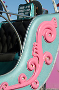 Pink and aqua detail of fairground ride, Blue Hill, Maine.