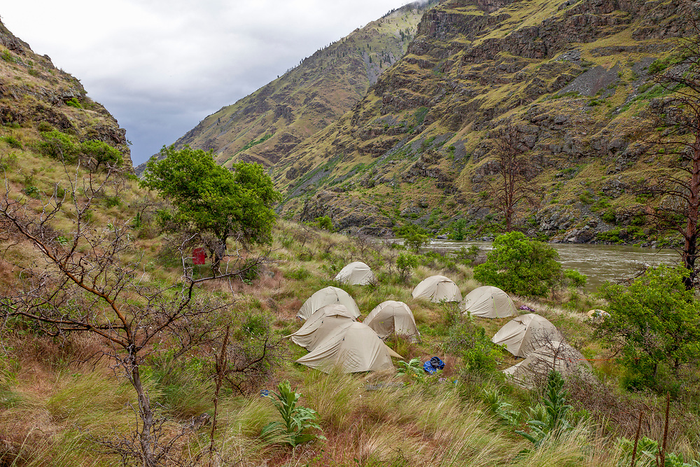 Licensing - Open Edition Prints<br /> Hells Canyon River Trip camping on Oregon side of river on a blustery rainy evening in springtime