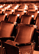 A row of chairs in an old North Carolina theatre