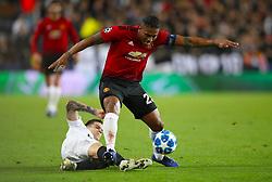 Manchester United's Antonio Valencia (right) and Valencia's Lorenzo Santi Mina battle for the ball
