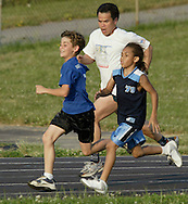 Times Herald-Record/TOM BUSHEY.Chris Connors, rear, runs with David Genender, left, and Tony Rousey during a 9-10 boys race at the Twilight Track and Field series at Middletown High School on July 8, 2003..