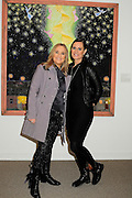 "Melissa Etheridge poses for a photo with her partner Linda Wallem, creator of Showtimes series Nurse Jackie at NMWA in front of one of Melissa's favorite paintings by Hollis Sigler called ""To Kiss The Spirits"" at the National Museum of Women in the Arts in Washington DC. Sunday Nov. 4th. Grammy award winner Melissa Etheridge was presented with The Excellence in the  Performing Arts award from the National Museum of Women in the Arts (NMWA). Etheridge  also performed on the piano and then an acoustic set on guitar for an intimate audience of about 400 people. Photo ©Suzi Altman/For NMWA Grammy award winner Melissa Etheridge is presented with the National Museum of Women in the Arts' (NMWA) Award for Excellence in the Performing Arts in Washington DC. Sunday Nov. 4, 2012. Etheridge also performed on the piano and then an acoustic set on guitar for an intimate audience of about 300 people. Photo ©Suzi Altman/For NMWA<br />