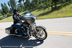Harley-Davidson employee Manon Durand riding a full dresser on the Harley-Davidson Angels Ride to benefit the Nature Conservancy during the annual Sturgis Black Hills Motorcycle Rally.  SD, USA.  August 12, 2016.  Photography ©2016 Michael Lichter.