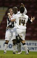Photo: Aidan Ellis.<br /> Bradford City v Swansea City. Coca Cola League 1. 13/01/2007.<br /> Swansea's Marcos Painter and Thomas Butler congratulate Adebayo Akinfenwa after he scored the second goal