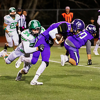 Photo: Jeffery Jones<br /> Miyamura Patriots Lance Evans (12) carries the ball Friday night while Farmington Scorpion Cissial Allison (34) tackles him at Angelo DiPaulo Memorial Stadium in a class 5-A district game.