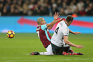 Sofiane Feghouli of West Ham United goes in with two footed challenge and fouls Phil Jones of Manchester United which leads to a red card and his sending off. Premier league match, West Ham Utd v Manchester Utd at the London Stadium, Queen Elizabeth Olympic Park in London on Monday 2nd January 2017.<br /> pic by John Patrick Fletcher, Andrew Orchard sports photography.