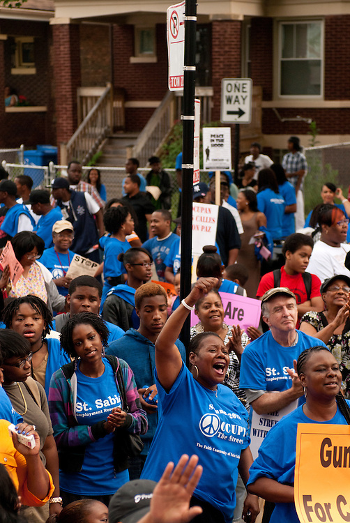 """The St. Sabina Faith Community host an """"Occupy the Streets"""" rally and march denouncing violence in the Auburn Gresham neighborhood on Chicago's south side on Friday, June 21st. The rally, held on the first day of summer when gun violence traditionally rises, includes a collection of faiths and local organizations dedicated to reducing violence. © 2013 Brian J. Morowczynski ViaPhotos<br /> <br /> For use in a single edition of Catholic New World Publications, Archdiocese of Chicago. Further use and/or distribution may be negotiated separately. <br /> <br /> Contact ViaPhotos at 708-602-0449 or email brian@viaphotos.com."""