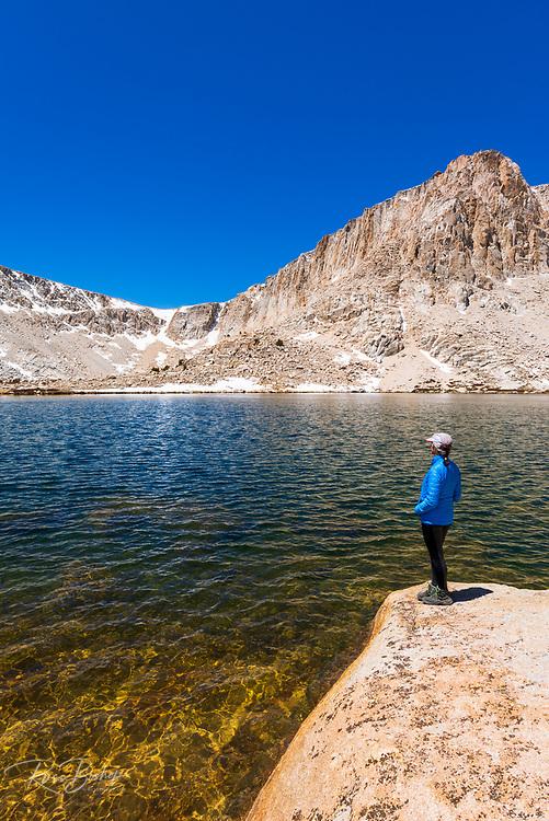 Hiker enjoying the view at Cottonwood Lake #5, John Muir Wilderness, California USA