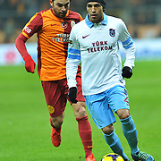 Galatasaray's Selcuk Inan (L) and Trabzonspor's Gustavo Colman (R) during their Turkish superleague soccer derby match Galatasaray between Trabzonspor at the AliSamiYen spor kompleksi TT Arena in Istanbul Turkey on Sunday, 22 December 2013. Photo by TURKPIX