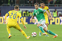 ROMANIA, Bucharest: Romania's Alexandru Maxim (L) and Northern Ireland's Aaron Hughes (R) vie for the ball during the Euro 2016 Group F qualifying football match Romania vs Northern Ireland in Bucharest, Romania on November 14, 2014.