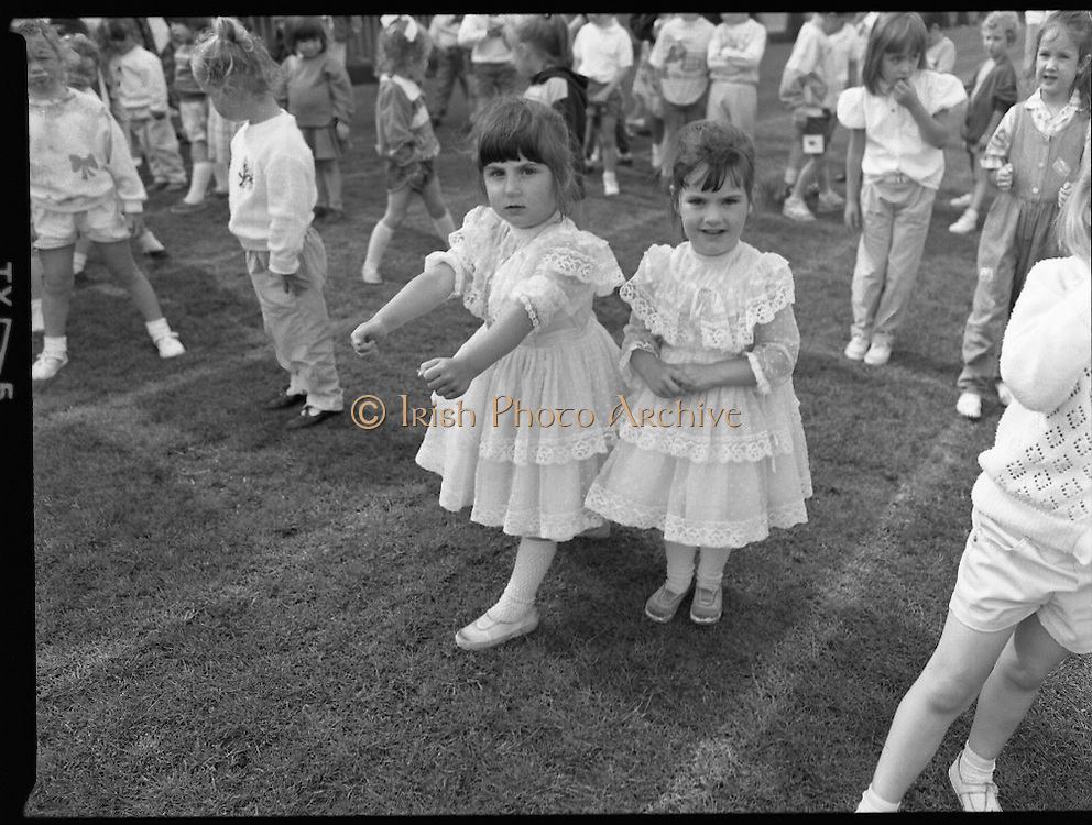 """Guinness Family Day At The Iveagh Gardens. (R83)..1988..02.07.1988..07.02.1988..2nd  July 1988..The family fun day for Guinness employees and their families took place at the Iveagh Gardens today. Top at the bill at the event were """"The Dubliners"""" who treated the crowd to a performance of all their hits. Ireland's penalty hero from Euro 88, Packie Bonner, was on hand to sign autographs for the fans...With the rain gone the tots and toddlers races got underway. The children are pictured at the start line."""