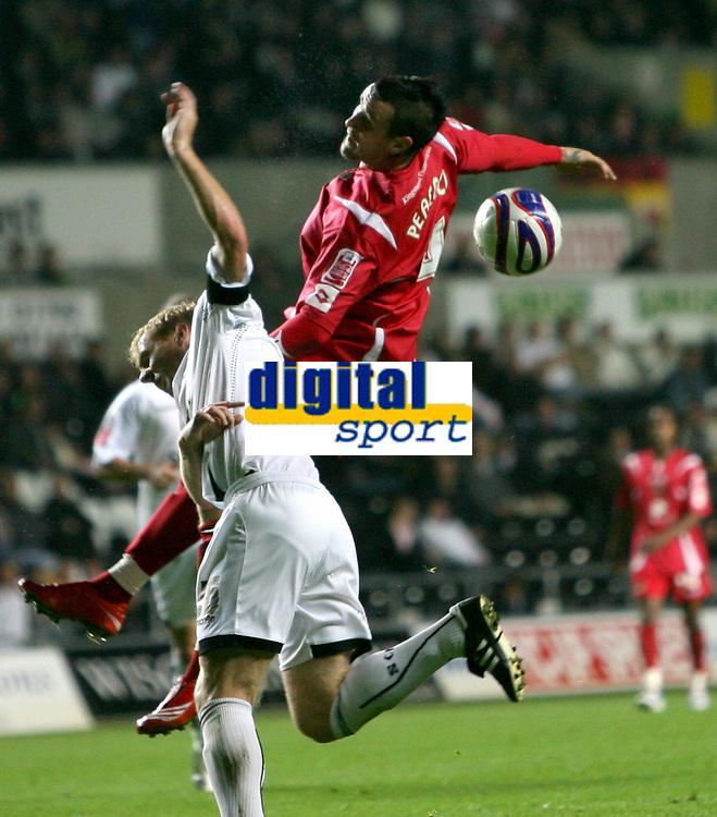 Photo: James Davies.<br />Swansea City v Swindon Town. Coca Cola League 1. 02/10/2007. <br />Swindon`s Lee Peacock battles with Garry Monk.