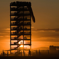 """Aug. 30 2008 - Black Rock City, Nevada, USA - The sunrises behind """"Babylon"""" a ten-story steel observation tower, Saturday morning, Aug. 30, 2008, during the Burning Man arts and culture festival in Black Rock City in the Black Rock Desert near Gerlach, Nev. (Credit Image: © David Calvert/ZUMA Press)"""