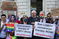 London, UK. 23rd June, 2021. Campaigners against LGBT+ conversion therapy, including Jayne Ozanne of the Ban Conversion Therapy Coalition (c) and veteran LGBT+ and human rights activist Peter Tatchell (r), attend a picket outside the Cabinet Office and Government Equalities Office. They also handed in a petition signed by 7,500 people calling on the government to fulfil its 2018 promise to ban LGBT+ conversion therapy.