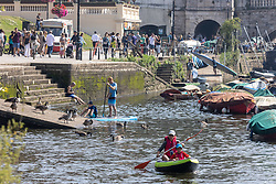 Licensed to London News Pictures. 05/09/2021. London, UK. Paddle boarders enjoy the warm sun along the Thames at Richmond, south-west London as weather forecaster predict a mini-heatwave for September from today with temperatures hitting over 27c tomorrow and throughout the week. Photo credit: Alex Lentati/LNP