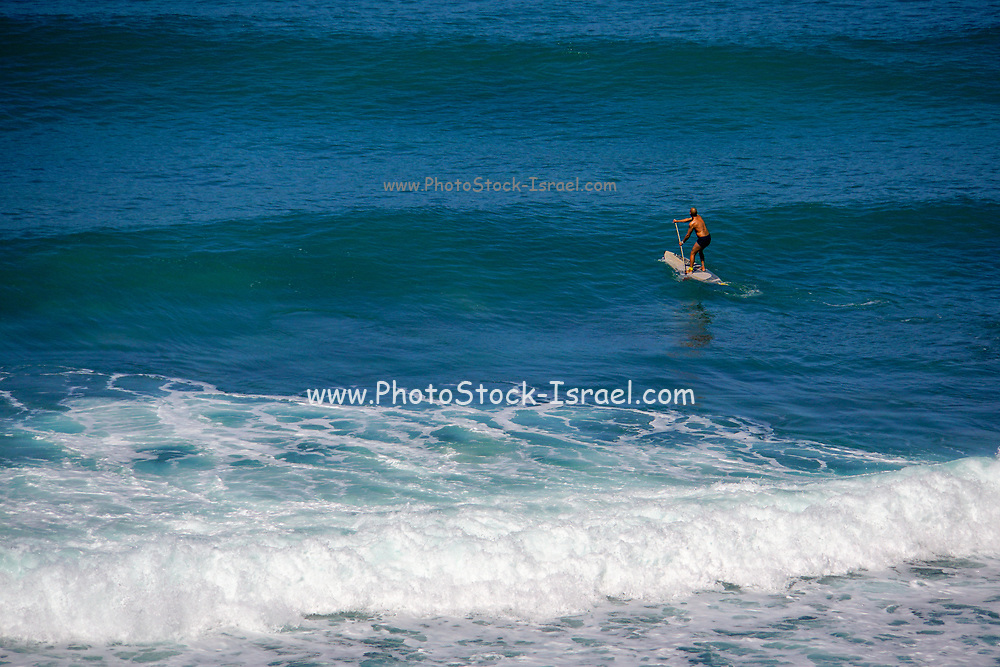 Paddle Surfer in the Mediterranean Sea