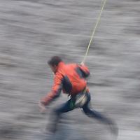 Eric Sethna pendulums across a face at Rundle Rock near Banff, Alberta, in Canada's Banff National Park.